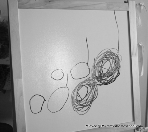 Vee 4 years old draws musical notes