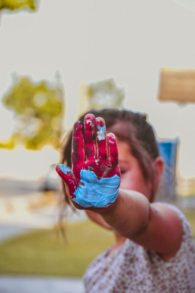 girl-hand-with-red-and-blue-paint